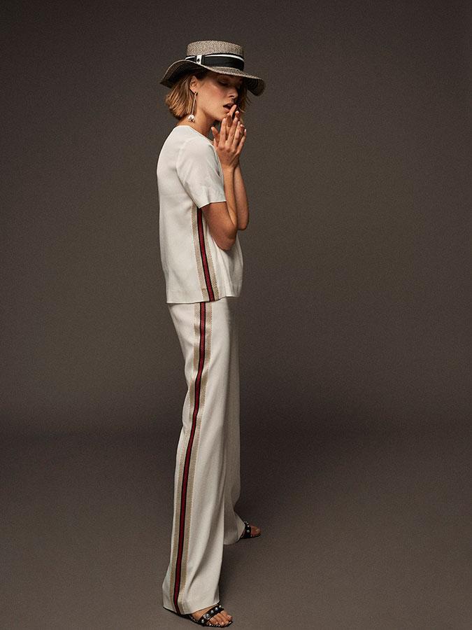 Conjunto de top y pantalón de Mirto, sombrero de Gloria Ortiz, pendientes de El Corte Inglés y sandalias de Zendra